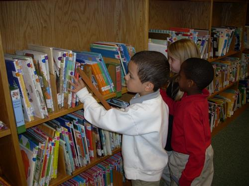 Children checking out books